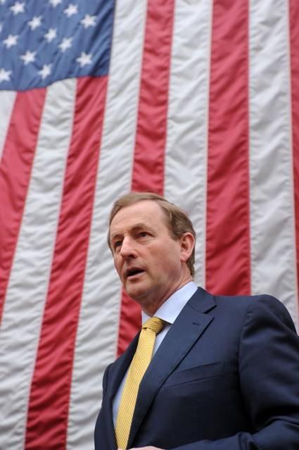 Taoiseach with flag of the United States of America in background