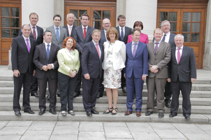 The Ministers of State gather for a photo with Taoiseach Enda Kenny and Tanaiste Joan Burton at Government Buildings