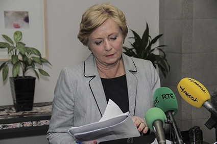 Minister Fitzgerald prepares to speak with the media