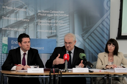 Department of Finance officials Niall Feerick, John Palmer and Annette Connolly at the Exchequer Returns press conference today